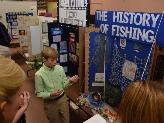 Jerad Saucier, an Oak Hill High School seventh-grader, talks about the history of fishing as he presents his project to judges at the Rapides Parish Social Studies Fair held Thursday.