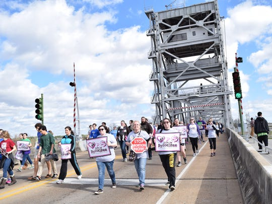 About 1,200 walkers crossed the Gillis-Long Bridge, also known as the Jackson Street Bridge, from Pineville to Alexandria during the Louisiana Life March on Saturday. The walk started at Louisiana College and ended at the Levee Park Amphitheater in downtown Alexandria.