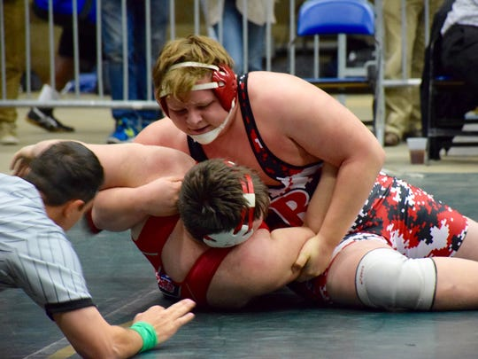 Riverheads' James Rea, top, takes Stonewall Jackson's Dakota Bush to his back during their 285-pound consolation semifinal at the Group 1A wrestling championship Saturday at the Salem Civic Center. Rea finished fourth.