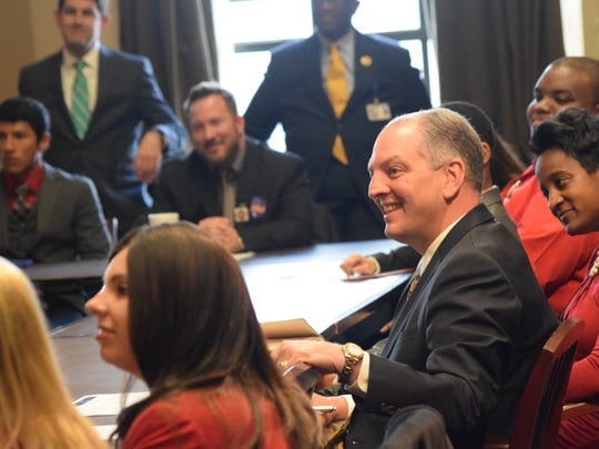 Gov. John Bel Edwards (center) meets with student body presidents from colleges and universities across Louisiana Wednesday at the state Capitol in Baton Rouge.