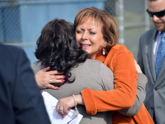 New Mexico Gov. Susana Martinez, center, hugs a family