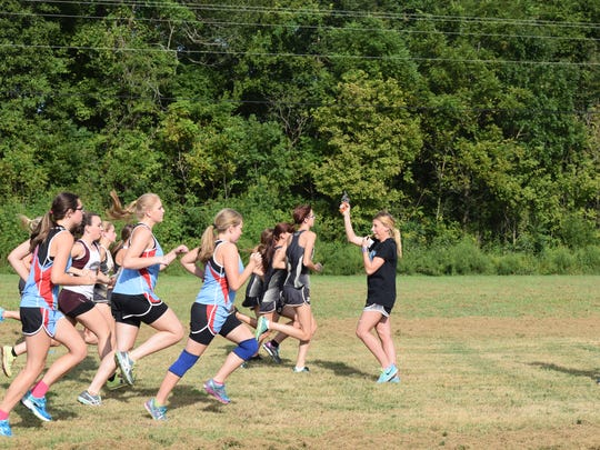 UC girls prepare for take off at the Cross Country meet.