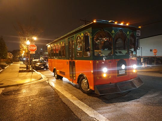 Baltimore's Holly Jolly Trolley Tour aboard an old-fashioned trolley visits the city's most decorated neighborhoods.