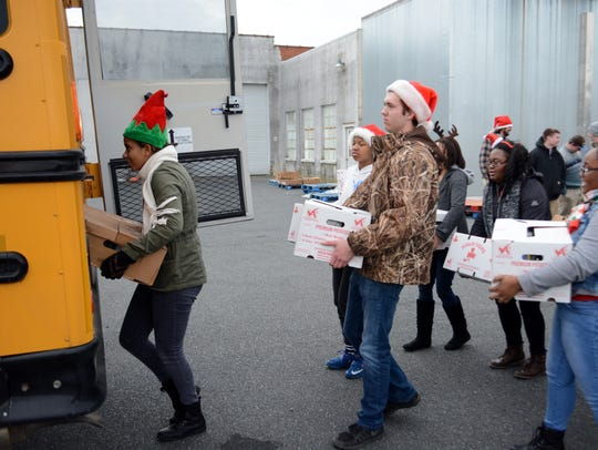 Northampton High School students load boxes at the