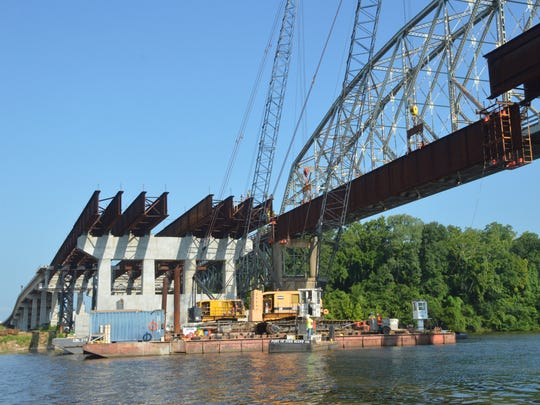 Workers place girders across the Red River as part of the new Curtis-Coleman Memorial Bridge in 2014. The $90 million bridge was completed in May.