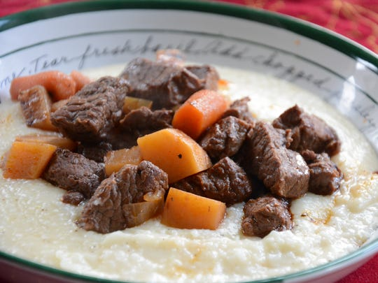 Braised Beef is served over grits or mashed potatoes.