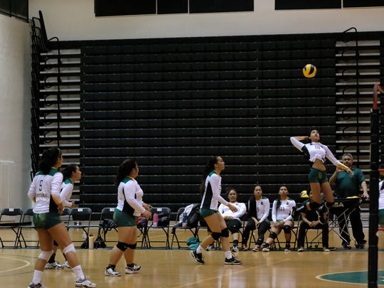 A UOG Varsity outside hitter goes up against the UOG Volleyball Club defense in a game held Feb. 9 at the UOG Calvo Field House.