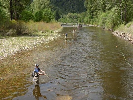 Fishermen try to tempt the trout of Rock Creek in May