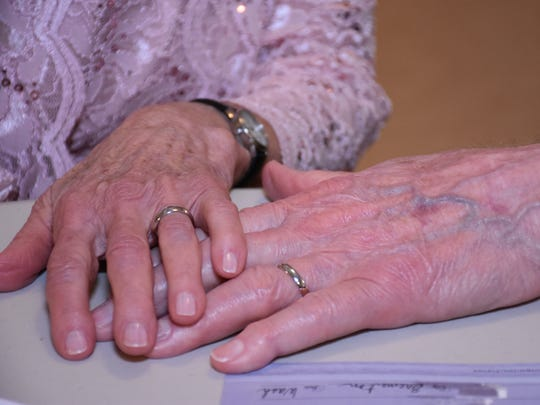 The hands of Leah Ritchie and David Law, who married Sunday in Port Gamble.