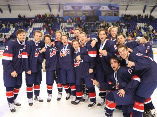 Celebrating after winning Sunday's gold medal game against Finland is the U.S. Under-18 Men's Hockey Team.