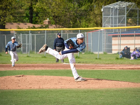Pitching during the seventh inning against Livonia Franklin is LIvonia Stevenson pitcher George Ferguson. He earned the save in the city championship final against LIvonia Franklin.