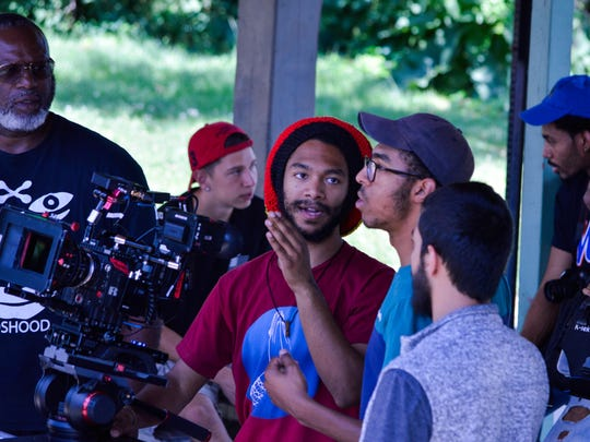 """Heroin(e)"" Director of Photography Kalani Mackson, 23, consults with his director and younger brother, Isaiah, 20, as Co-director Patrick Coker looks on. Produced by the Macksons' father, Lamar, the gritty 10-minute drama is expected to be released in early 2018."