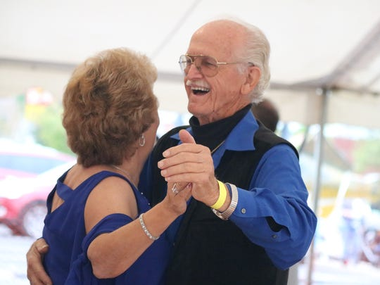 Irene Hilpert, right, and Ted Harris dance to polka