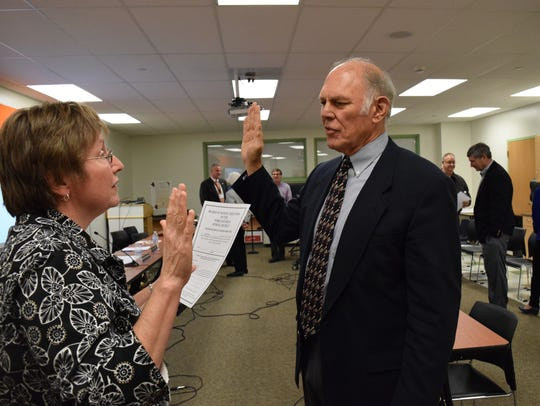 Joel Sears, right, is sworn in by York Suburban Administrative