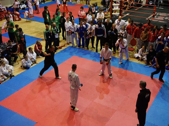 A crowd of spectators watch as Hunter Carney competes at the World Karate Union championships, held in August in Ireland.