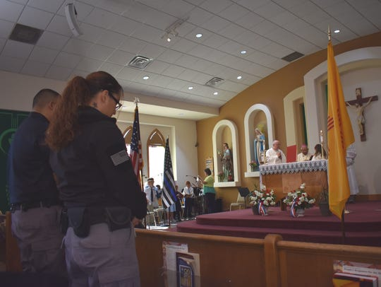 In this file photo, officers bow their heads in prayer during the Blue Mass held earlier in February, a Catholic mass held at Immaculate Conception Church. The mass honored local police, fire and first responders.