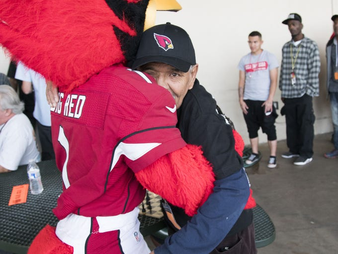 Arizona Cardinals mascot hugs Jimmy Marquez, 61, before