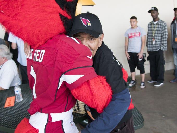 Arizona Cardinals mascot hugs Jimmy Marquez, 61, before