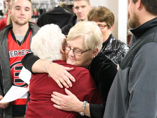 Sharon McCullough, of the Portage Resale Center, hugs one of the more than 50 recipients of donations totaling $125,000.