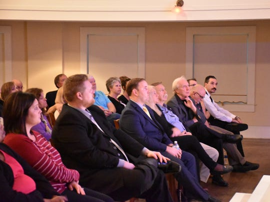 An audience that includes  Milton Mayor Wesley Meiss, center, listen Thursday, Nov. 30, 2017, as Quint Studer addresses how to redevelop the city of Milton during a talk at the Imogene Theater in downtown Milton.