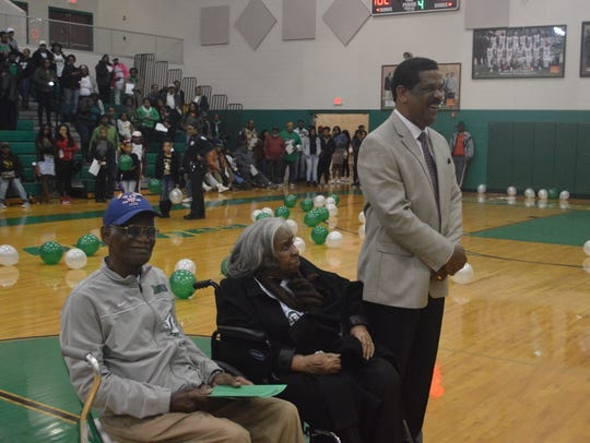 Peabody coach Charles Smith (right) shares a laugh