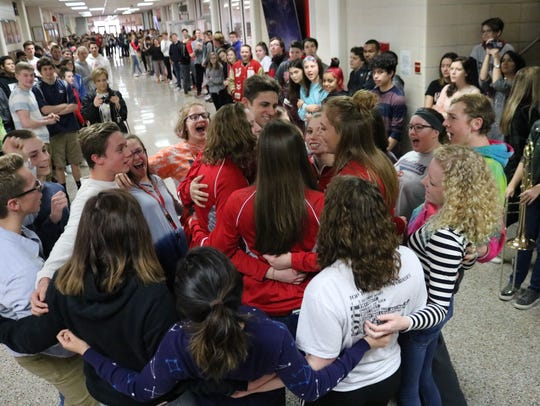 Port Clinton High School students cheer swimmers Jack Kessler, Rachel Simpson, Lauren Shaw, Elena Kessler and Bryanna Barr before they head to Canton to compete in the state championship tournament.