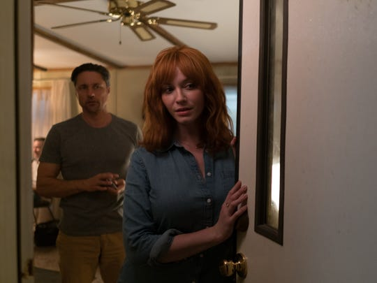 """While spending the night in an abandoned trailer park, Cindy (Christina Hendricks) and Mike (Martin Henderson) are greeted by an unwelcome visitor in """"The Strangers: Prey at Night."""""""