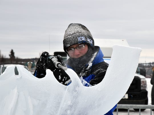 Kaitlin Pfropper (Fraser, Mich.) working on an ice carving at the 2018 De Beers Inspired Ice International Ice Carving Competition.