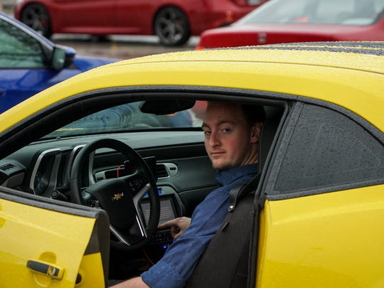 Garrett Griffith, of Maryville, shows off the deafening speaker system in his Chevy Camaro during the Spring 2018 Harper Cars and Coffee auto show on Sunday, April 15.