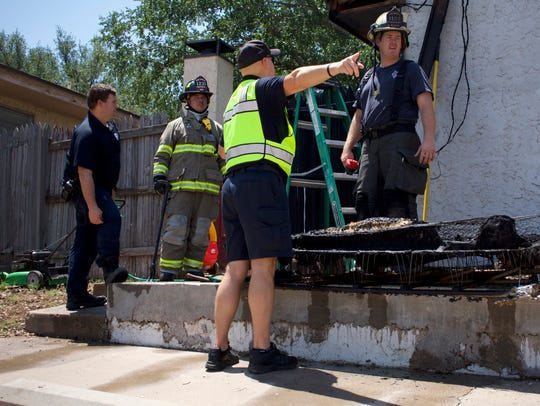 San Angelo firefighters examine the area where a burning