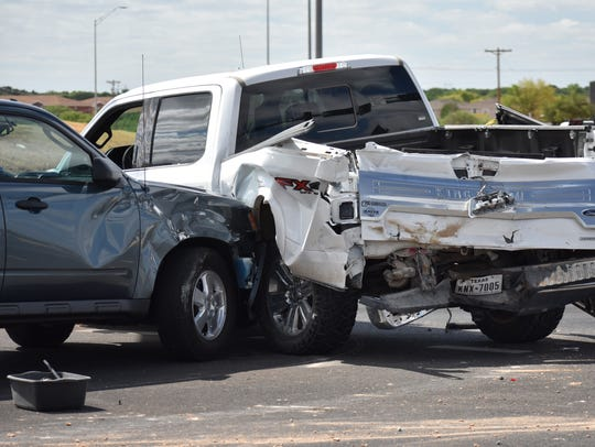 A blue SUV collided with a white truck during a wreck