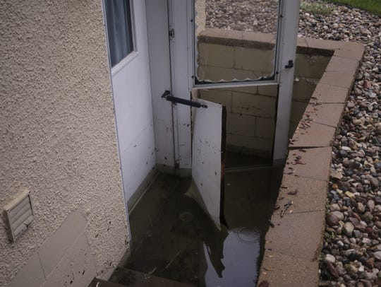 Amy Christie's back door was broken when flood waters