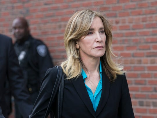 Felicity Huffman leaves the John J Moakley Federal