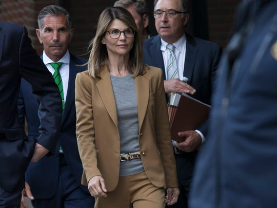 Lori Loughlin and her husband, Mossimo Giannulli, leave the John J. Moakley Federal Courthouse after facing charges in a nationwide college admissions cheating scheme in Boston.