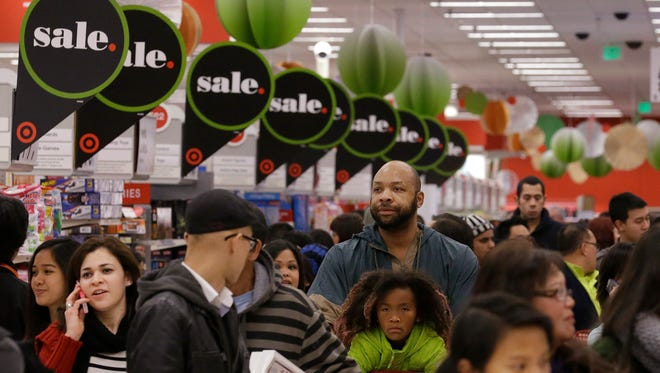 People shop at a Target store in Colma, Calif.,  in November.