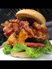 The Corner Grill specializes in burgers that are sure to tempt your taste buds.