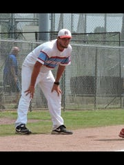 Tyler Peeler coaches the Madison South 12u all-stars at third base during a recent game.