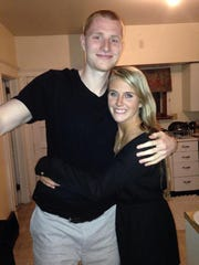 Aaron White and longtime girlfriend Grace Burns, a former Iowa volleyball player.