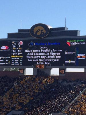 U.S. Air Force pilot Major Eric Flattem is stationed in the Middle East and sent a message to his wife, Laura Neary, on the University of Iowa scoreboard during Saturday's game.