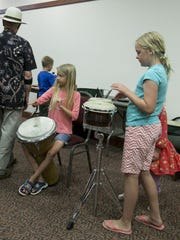 Kids are given the chance to try out all kinds of musical instruments before the show in the Heritage Center Theater in Cedar City on Monday, kicking off the week-long Groovefest.
