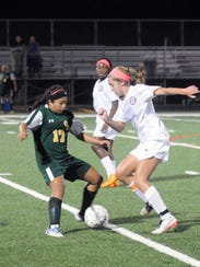 Snow Hill's Kelsey Hall dribbles through a Queen Anne's