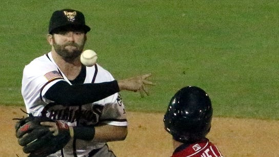 El Paso Chihuahuas infielder Casey McElroy fires to
