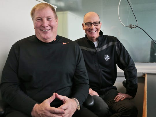 Bengals radio color commentator Dave Lapham, left,