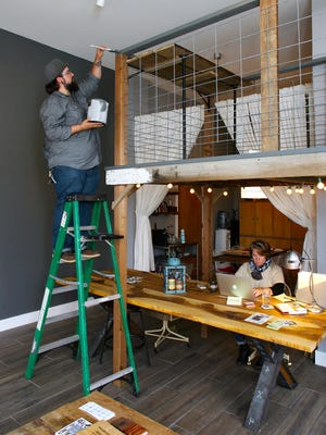 Chad DiBlasio, left, owner of DiBlasio Photo and Design, and Jodi Melfi, owner of Jodi Melfi Design, have opened a new creative co-working space, creative coop, in a loft-inspired storefront on North Prospect Street in downtown Granville.