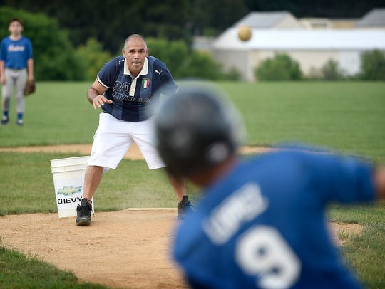 Michael Piester warms up his batters before a big game