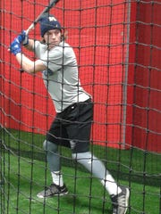 Cade Parmeter, Lakeland High School senior, practices batting at the new Huron Valley Athletic Complex.