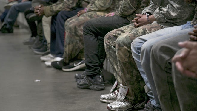 Prisoners await processing at Maricopa County's Fourth Avenue Jail in Phoenix.