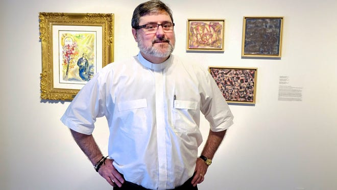 """Rev. Paul Bienvenu at  """"French Connection,"""" an exhibit of his personal art collection at the Acadiana Center for the Arts in Lafayette Thurs., July 13,  2017."""