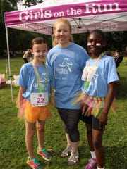 Bear Elementary School teacher Sarah Francis is flanked by students Margaret Hornsby, left, and Ariyana Simon after Saturday's Girls on the Run race is completed. Alvin Benn/Special to the Advertiser.