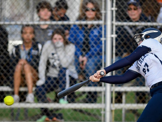 Reitz's Mikayla Jolly (27) gets a first inning hit off of Mater Dei's Allie Goodin (28) as the Mater Dei Wildcats play the Reitz Panthers at Evansville's Howell Park Thursday, April 5, 2018.